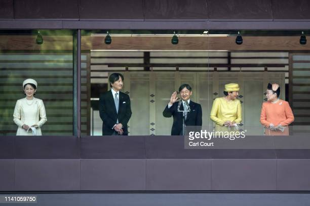 Emperor Naruhito of Japan waves to members of the public after making a public speech on the balcony of the Imperial Palace on May 4 2019 in Tokyo...