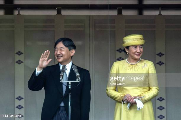 Emperor Naruhito of Japan waves to members of the public as his wife Empress Masako stands beside him on the balcony of the Imperial Palace on May 4...