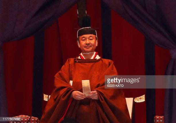 Emperor Naruhito officially proclaims his ascension to the Chrysanthemum Throne during an enthronement ceremony at the Imperial Palace in Tokyo on...