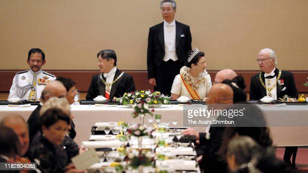 Emperor Naruhito talks with Sultan Hassanal Bolkiah of Brunei Darussalam while Empress Masako talks with King Carl XVI Gustaf of Sweden during the...