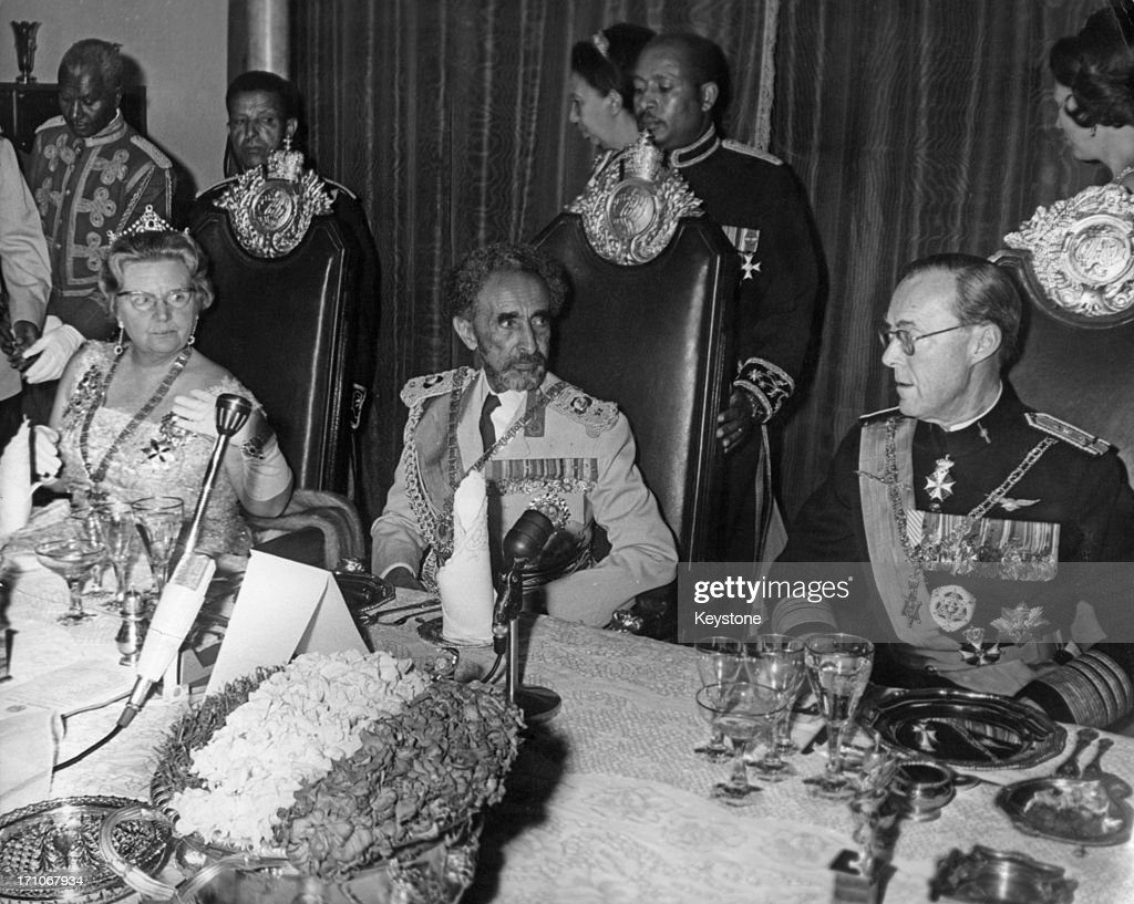 Emperor of Ethiopia Haile Selassie I (1892 - 1975, centre) with his guests Queen Juliana of the Netherlands (1909 - 2004) and Prince Bernhard (1911 - 2004) at a dinner in Addis Ababa, Ethiopia, 26th January 1969. The Dutch royal couple are on an official visit to Ethiopia.