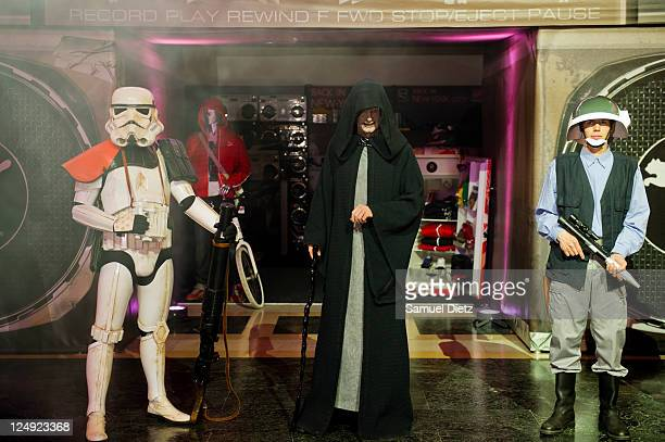 Emperor Palpatine with a Stormtrooper and a Rebeltrooper at the Star Wars Saga release party at Virgin Megastore Champs-Elysees on September 13, 2011...