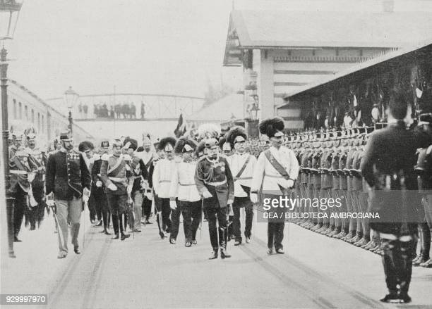 Emperors Franz Joseph I of Austria and Wilhelm II of Prussia and Germany followed by the archdukes reviewing the ceremonial guard at Penzing station...