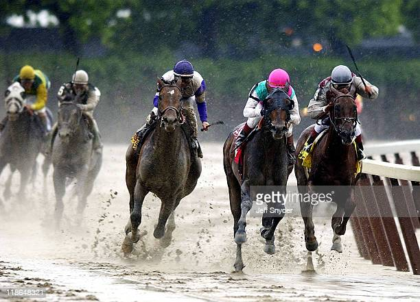 Empire Maker making his move in the final turn during Empire Maker Wins The 2003 Belmont Stakes at Belmont Racetrack in Elmont New York United States