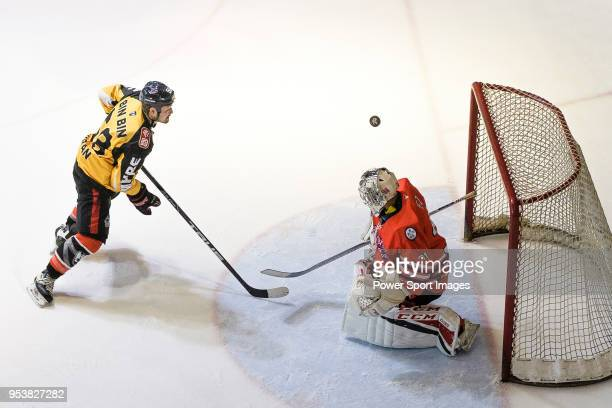 Empire Skater Bim Bim fights for the puck with Kowloon Goalie Vez during the Mega Ice Hockey 5s match between Kowloon Generals and Empire Skate on...