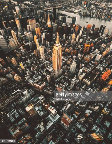 empire state building aerial view at dusk - brooklyn new york stock photos and pictures