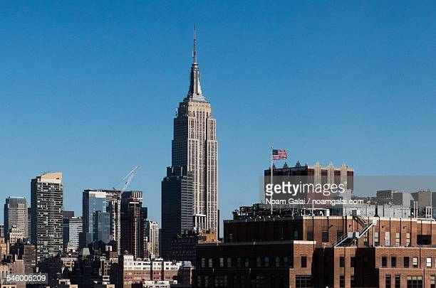 empire state building and midtown nyc - noam galai stock pictures, royalty-free photos & images