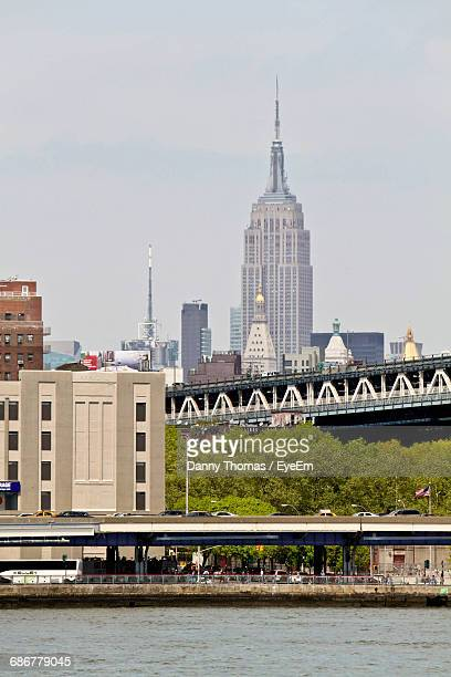Empire State Building In City Against Sky