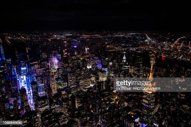 empire state building in new york at night - sixth avenue stock pictures, royalty-free photos & images