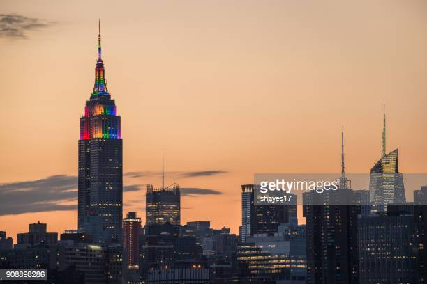 empire state building pride sunset - pride stock pictures, royalty-free photos & images