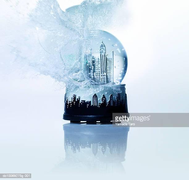 Empire State building snow globe exploding, close-up