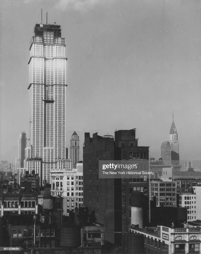 Empire State Building Under Construction With View Of Chrysler In Background New York
