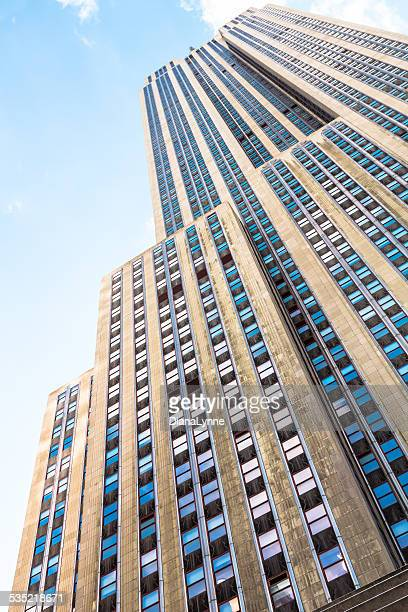 View from street level looking up to top of the famous Art Deco Empire State Building in New york City.