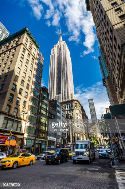 empire state building yellow taxi fifth avenue new york manhattan - broadway manhattan stock photos and pictures