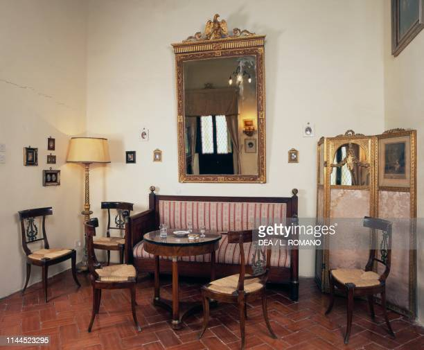 Empirestyle sitting room known as Napoleonic due to numerous relics from the Bonaparte family Sanluri castle Sardinia Italy