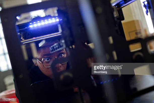 Employee Adjua Greaves assembles a Makerbot Industries LLC 3D Printer at the company's new factory in the Brooklyn borough of New York US on Thursday...