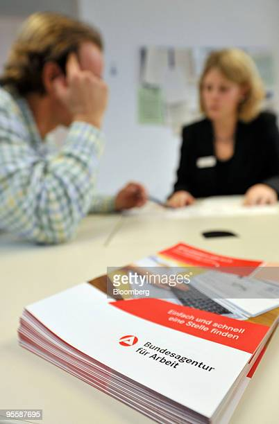 Employee Annabel Huhn right assists a job seeker at an unemployment office or Arbeitsagentur in Rosenheim Germany on Tuesday Jan 5 2010 German...