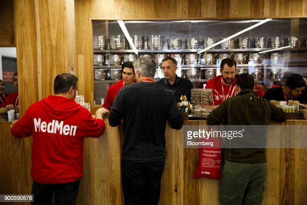 Employee assist customers at the MedMen dispensary in West Hollywood California US on Tuesday Jan 2 2018 California launched legal marijuana Monday...
