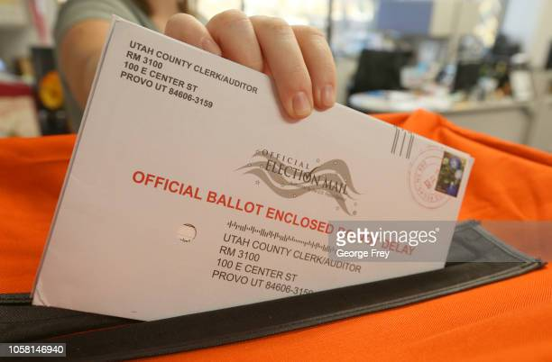 A employee at the Utah County Election office puts mail in ballots into a container to register the vote in the midterm elections on November 6 2018...