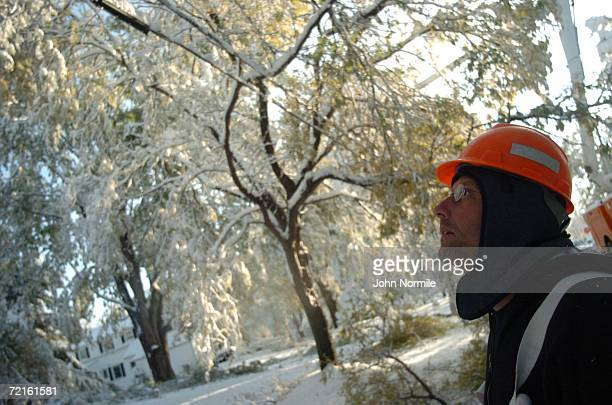 Employee Bill Gowin checks power lines October 13, 2006 outside of Buffalo in Orchard Park, New York. A rare and record breaking early season...