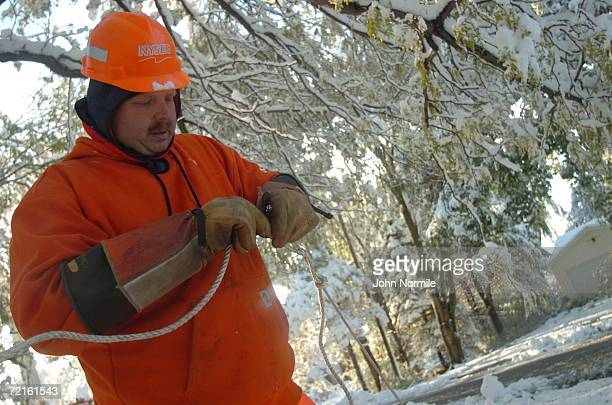 Employee Brett Skeels checks power lines October 13, 2006 outside of Buffalo in Orchard Park, New York. A rare and record breaking early season...