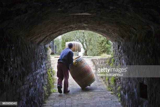 Employee carrying a barrel outside the Argiano wine cellar on October 21, 2011 in Montalcino, Italy. It's here, that since the sixteenth century, the...
