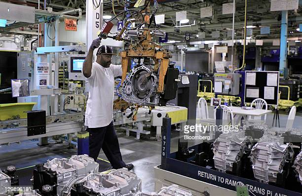 Employee Clay Cannon removes a finished transmission from the assembly line at the General Motors Co. Transmission plant in Warren, Michigan, U.S.,...