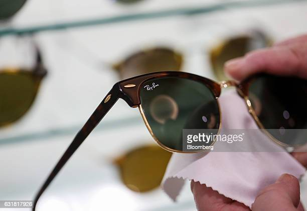 d59ca74f093 A employee cleans a pair of RayBan Clubmaster luxury sunglasses manufactured  by Luxottica Group SpA in
