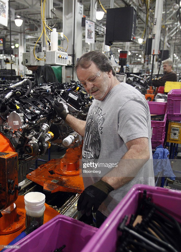 Employee Cliff McCloskey assembles an 2.0 liter ecoboost engines on the production line at the Ford Motor Co. Cleveland Engine Plant in Brook Park, Ohio, U.S., on Thursday, Feb. 21, 2013. Ford Motor Co. said it will invest $200 million to make four-cylinder engines at the plant starting in late 2014 as the second-largest U.S. automaker equips an increasing number of models with smaller, more fuel-efficient powertrains. Photographer: David Maxwell/Bloomberg via Getty Images
