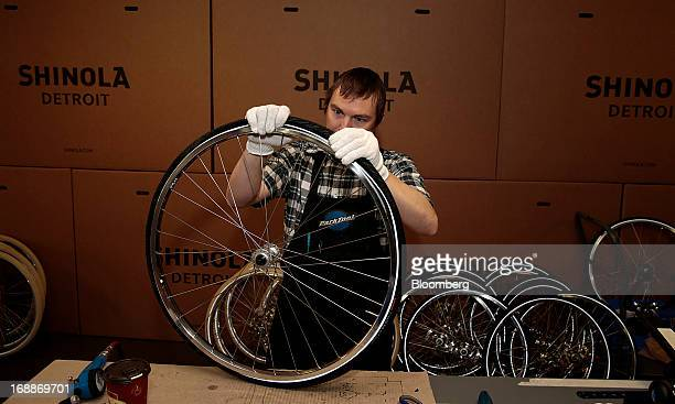 Employee Courtney Whitinger assembles the wheel of a bicycle at the Shinola production facility in Detroit Michigan US on Wednesday May 15 2013...