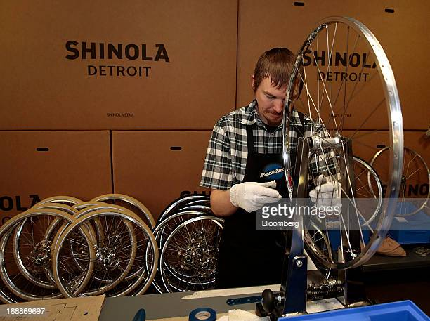 Employee Courtney Whitinger checks the wheel frame of a bicycle at the Shinola production facility in Detroit Michigan US on Wednesday May 15 2013...