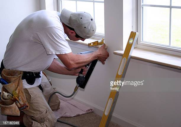 employee diligently working in summer time on window - installing stock pictures, royalty-free photos & images