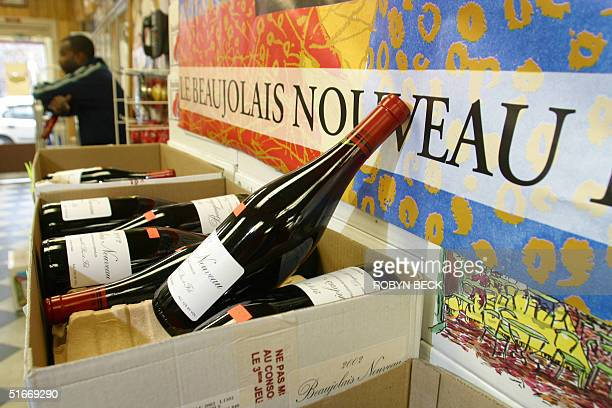 Employee Donald Poole takes a rest after helping to unload the 200 cases of 2002 Beaujolais Nouveau which arrived at Pearson's Wine Shop in...