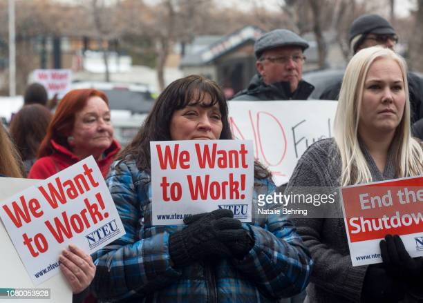 IRS employee Donna Orton holds a sign protesting the government shutdown at the James V Hansen Federal Building on January 10 2019 in Ogden Utah As...