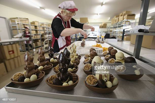 Employee Doreen Krohe packs chocolate Easter bunnies and eggs at the production facility at Confiserie Felicitas chocolates maker on April 9 2014 in...