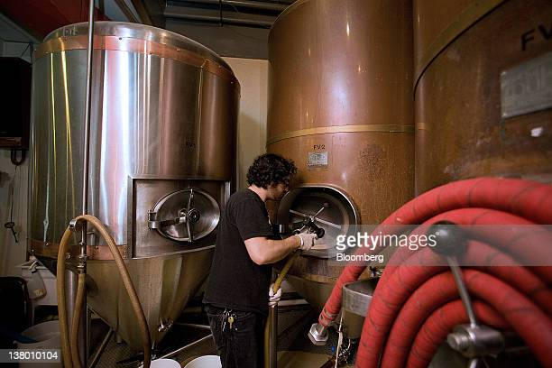 Employee Eric Erman cleans a tank at the Wynkoop Brewing Co in Denver Colorado US on Thursday Jan 26 2012 The Wynkoop Brewing Co was founded in 1988...