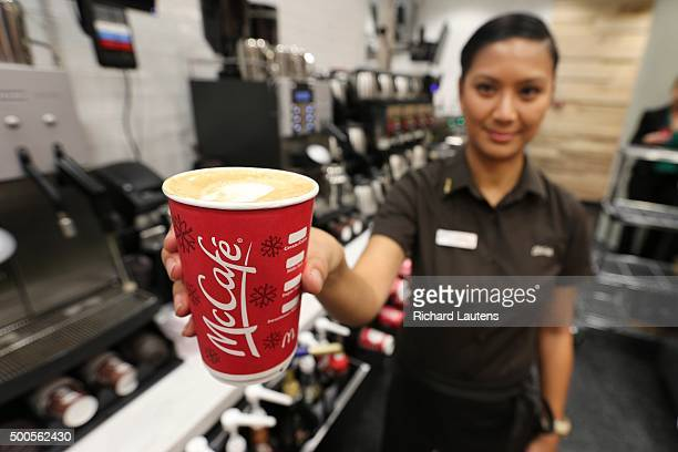 TORONTO ON DECEMBER 8 Employee Erika Resulto makes a soy latte Monster success of its coffee prompts McDonald's to launch its first standalone McCafe...