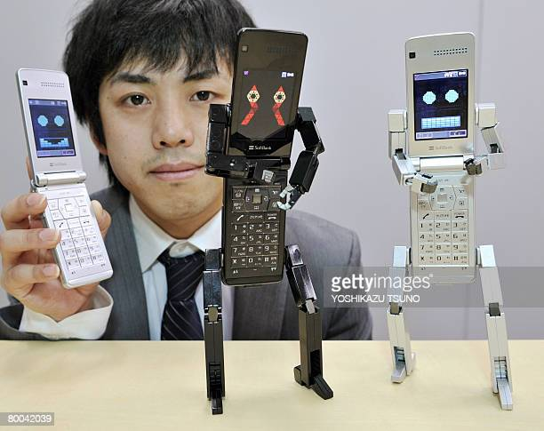Employee for Japanese mobile communication giant Softbank Kenichi Yuasa displays the mobile phone called the 'Softbank 815T PB ' produced by Japanese...