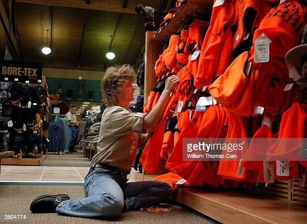 Employee Gail Hippert places hunting gear on the shelves at Cabela's September 17 2003 in Hamburg Pennsylvania Cabela's 250000 square foot first...