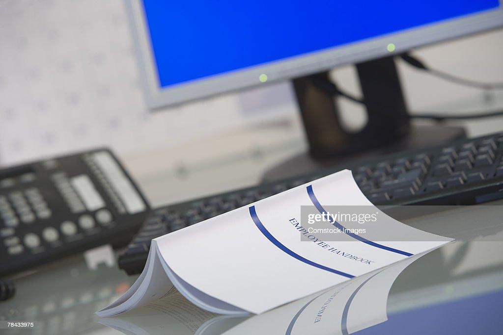 Employee handbook on desk : Foto de stock