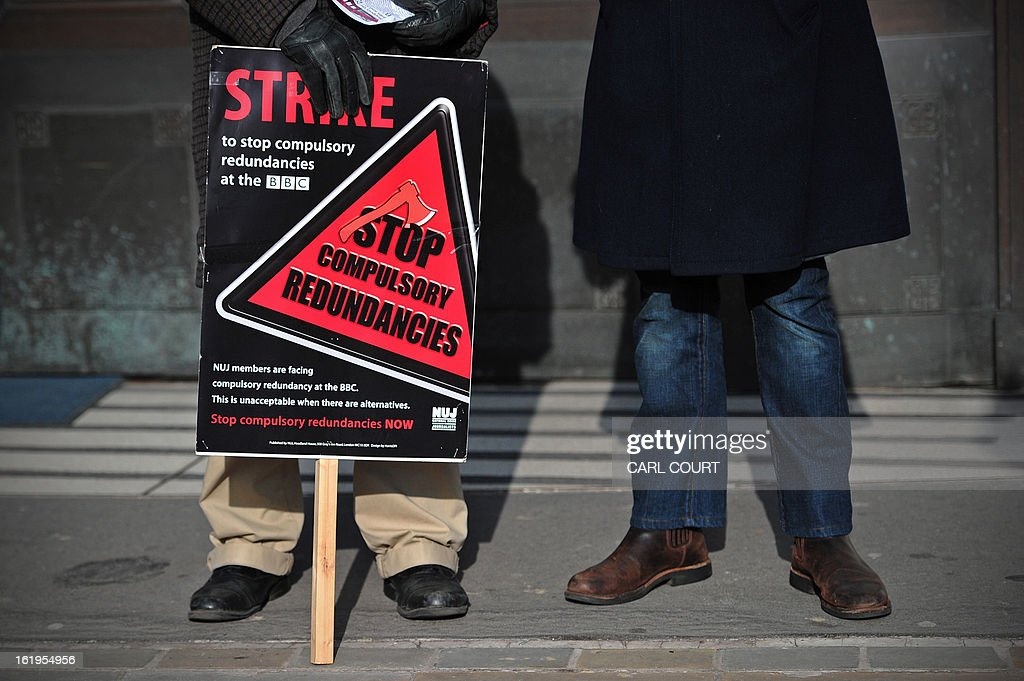 A BBC employee holds a placard outside Broadcasting House in central London on February 18, 2013, as he mans a picket line during a strike over compulsory redundancies. Today, February 18, 2013, BBC journalists began a 24-hour strike in protest at compulsory redundancies, causing possible disruption to the broadcaster's television and radio output. Members of the National Union of Journalists (NUJ) walked out at midnight (local time and GMT) at the end of Sunday's programming, over job cuts which are expected to affect BBC Scotland, Five Live, the Asian Network and the World Service.