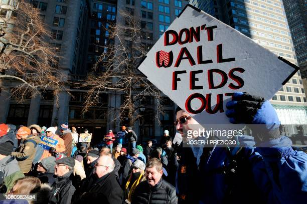 EPA employee Hugh Martinez attends a protest rally by government workers and concerned citizens against the government shutdown on Friday January 11...