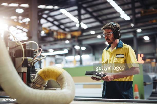 Employee in Australia working with automated machine