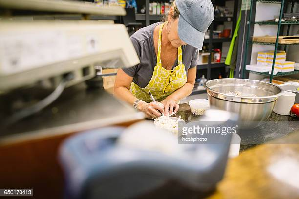 employee in general store writing notes in kitchen - heshphoto stock pictures, royalty-free photos & images