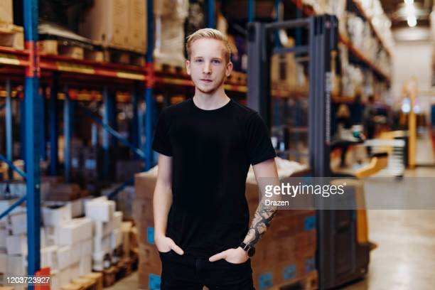 employee in warehouse, driving forklift - scandinavian descent stock pictures, royalty-free photos & images