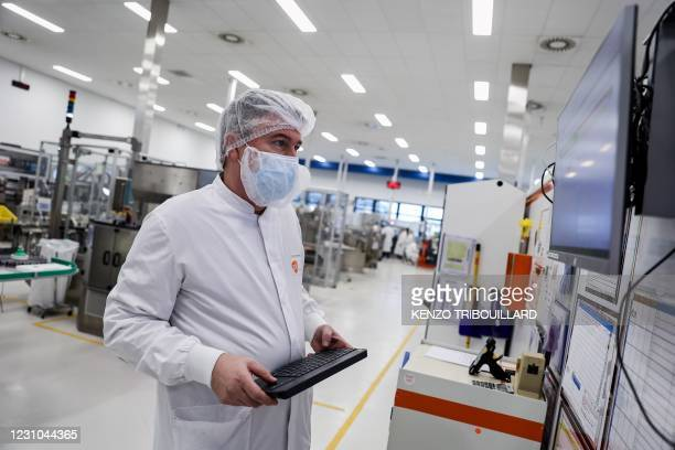 Employee is at work at the factory of British pharmaceutical company GlaxoSmithKline in Wavre on February 8, 2021 where the Covid-19 CureVac vaccine...