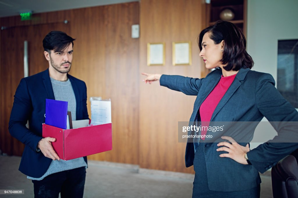 Employee is fired from his manager in the CEO office : Stock Photo