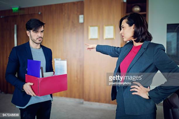 employee is fired from his manager in the ceo office - being fired stock pictures, royalty-free photos & images