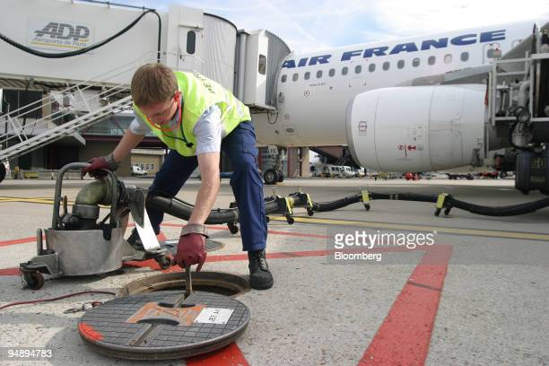 BP employee is seen refueling an Air France plane on the tarmac at Orly International Airport near Paris France Monday August 23 2004 European...