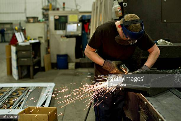 Employee Jon Goerdt uses a grinder at the Giese Manufacturing Co in Dubuque Iowa US on Thursday Feb 14 2013 The US Federal Reserve is schedule to...
